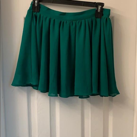 Forever 21 Dresses & Skirts - Flirty green mini skirt.